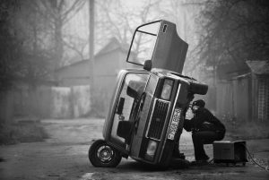 man-repairing-the-old-soviet-car-on-the-outskirts-of-the-city-of-mogilev-in-eastern-belarus-by-mihail-kopychko